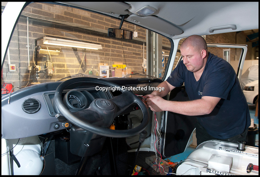 BNPS.co.uk (01202 558833)<br /> Pic: LauraJones/BNPS<br /> <br /> Service technician Andrew Page working on some accessory wiring.<br /> <br /> The last ever delivery of brand new Volkswagen campervans has arrived in Britain marking the end of an era for the iconic 'hippy bus'.<br /> <br /> Ninety nine of the final batch of vans rolled off the production line and onto a container ship bound for British shores after manufacture ceased for good in Brazil in December.<br /> <br /> And though the consignment has only just arrived, almost all of the vans have already been snapped up by eager buyers happy to fork out the £35,000 starting price.<br /> <br /> They are the last brand new campers in all of Europe.