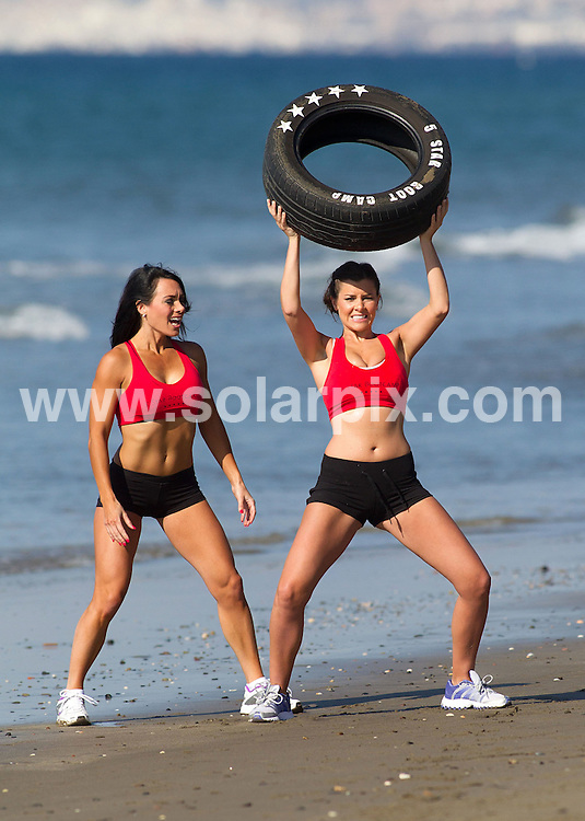 "**ALL-ROUND EXCLUSIVE PICTURES FROM SOLARPIX.COM** . **WORLDWIDE SYNDICATION RIGHTS** Sexy Imogen Thomas got into some serious training this week after her holiday in Thailand, where she claimed she'd been ""eating like a horse"". The ex Big Brother contestant spent a few days working out at the ""5 Star Bootcamp"" in Marbella, which is run by 27-year-old health and fitness journalist Danni Levy..Imogen was put through a gruelling fitness regime which included kick boxing, turning tyres, running with a parachute strapped to her back and swinging a sledge hammer. - What better place to do it than a sun kissed beach on the Costa del Sol? .This pic: Imogen Thomas JOB REF: 14599 AB1sf DATE: 24.03.12 **MUST CREDIT SOLARPIX.COM OR DOUBLE FEE WILL BE CHARGED** **MUST AGREE FEE BEFORE ONLINE USAGE** **CALL US ON: +34 952 811 768 or LOW RATE FROM UK 0844 617 7637**"