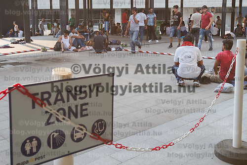 Illegal migrants sit in a public underpass designated as a transit zone at Eastern railway station in downtown Budapest, Hungary on August 13, 2015. ATTILA VOLGYI