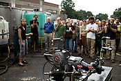 July 30, 2008. Durham, NC.. Meeting of the Peak Oil group at the Carolina Biofuels campus.. Members discussed the efforts of local groups, such as Carolina Biodiesel and Piedmont Biofuels, that have created homegrown movements to expand the use of bio-fuels and alternative energy sources.. The gathered crowd listens to a discussion of the cavitator, bottom of frame, the machine that helps Carolina Biofuels produce bio-diesel on site.