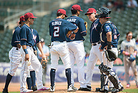 NWA Democrat-Gazette/CHARLIE KAIJO Northwest Arkansas Naturals pitching coach Steve Luebber (46) talks to Northwest Arkansas Naturals pitcher Emilio Ogando (23) during a baseball game, Sunday, May 13, 2018 at Arvest Ballpark in Springdale.