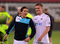 Pictured: (L-R) Aaron Lewis and Adam King of Swansea City celebrate their win after the game Monday 15 May 2017<br />