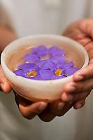 A bowl of floating nasturtium flowers