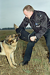 Pix: Shaun Flannery/shaunflanneryphotography.com...COPYRIGHT PICTURE>>SHAUN FLANNERY>01302-570814>>07778315553>>..8th September 1985..A South Yorkshire Police dog handler with his Alsatian dog on an exercise circa 1995.