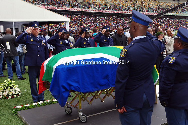 DURBAN - 1 November 2014 - An honour guard of the South African Police Services salute as the national anthem is played at the funeral of slain South African soccer captain Senzo Meyiwa in Durban's Moses Mabhida Stadium. Meyiwa, who was also the goal keeper for Orlando Pirates, was gunned down in Vosloorus a week earlier. while visiting his girlfriend's house during a robbery. Picture: Allied Picture Press/APP