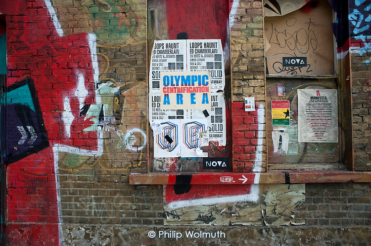 Olympic Gentrification Area.  Graffiti on the wall of a disused pub in Hackney Wick.  The rundown area of warehouses, small industrial units and tenement blocks next to the London 2012 Olympic Park has seen a recent influx of young artists attracted by the availability of cheap accommmodation and studio space.