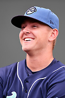 Starting pitcher Will Gaddis (25) of the Asheville Tourists warms up before a game against the Greenville Drive on Friday, June 1, 2018, at Fluor Field at the West End in Greenville, South Carolina. Greenville won, 7-4. (Tom Priddy/Four Seam Images)