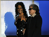 """Washington, DC - October 13, 2009 -- Sheila E. and Jose Feliciano walk on to the stage to perform at a White House Music Series """"Fiesta Latina"""" with United States President Barack Obama on the South Lawn of the White House in Washington on Tuesday, October 13, 2009..Credit: Alexis C. Glenn / Pool via CNP"""