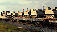 Railroad Flat Cars loaded with Military equipment for shipment to Far East for Operation Desert Storm. Houston Texas USA Port of Houston.