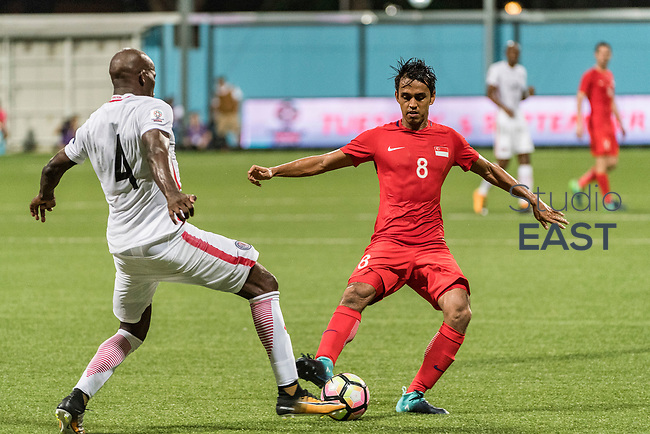 SINGAPORE, SINGAPORE - AUGUST 31: Shahdan Sulaiman of Singapore (R) fights Jean Jacques Kilama of Hong Kong (L) for the ball during the international friendly match between Singapore and Hong Kong at the Jalan Besar Stadium on August 31, 2017, in Singapore, Singapore. (Photo by Getty Images)
