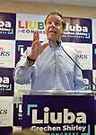 assapequa, New York, USA. August 5, 2018. L-R, Governor ANDREW CUOMO, running for re-election, speaks at podium at opening of joint campaign office for Liuba Grechen Shirley, Congressional candidate for NY 2nd District; and NY Senator John Brooks, aiming for a Democratic Blue Wave in November midterm elections.