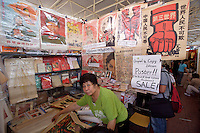 Panjiayuan weekend market. Shop selling original revolutionary and Chairman Mao Posters and Mao Bibles.