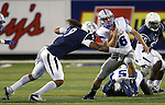 Nevada defender Matthew Lyons tackles Air Force quarterback Karson Roberts during the second half of an NCAA football game in Reno, Nev., on Saturday, Sept. 28, 2013.<br /> Photo by Cathleen Allison
