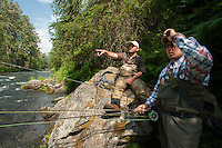 150620-JRE-7981E-0913 Joshua Quong, right, and Cal Trout, left, both teachers and quail hunting guides from Mississippi, learn to spot rising rainbow trout on the Russian River.