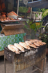 Grilling fish and meat, Bangkok, Thailand.