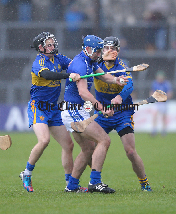 Colin Ryan and Mike Mc Inerney of Newmarket On Fergus in action against Conor Ryan of Cratloe during the senior county hurling final at Cusack Park. Photograph by John Kelly.
