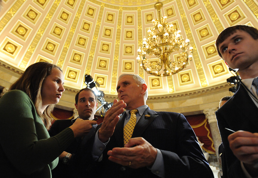 (center) Mike Pence (R-IN) House Republican Conference Chairman, answers media questions before the State of the Union address on Wed. Jan. 27, 2010. (Amanda Lucidon/For The New York Times)