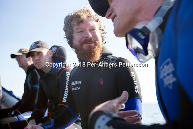 MARGATE, SOUTH AFRICA APRIL 25: Divers head out for a shark dive trip, with an African Adventure diving boat, during an early morning dive at Protea Banks on April 25, 2018 in KwaZulu Natal, South Africa. The area is one of the best in South Africa for shark encounters. (Photo by: Per-Anders Pettersson/Getty Images)