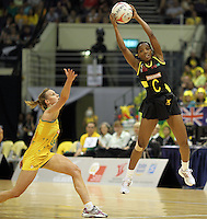 09.07.2011 Jamaica's Paula Thompson in action during the netball match between Jamaica and Australia at the Mission Foods World Netball Championship 2011 held at the Singapore Indoor Stadium in Singapore . Mandatory Photo Credit ©Michael Bradley.