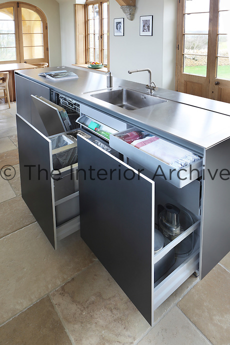 The kitchen island has a dedicated washing area complete with sink and integrated dishwasher and a recycling centre