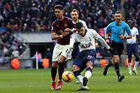 Erik Lamela of Tottenham Hotspur and Ayoze Perez of Newcastle United during Tottenham Hotspur vs Newcastle United, Premier League Football at Wembley Stadium on 2nd February 2019