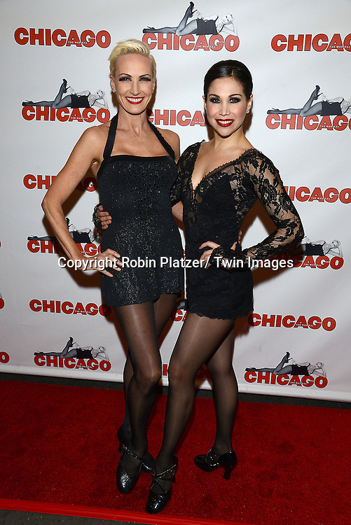 """Amra-Faye Wright and Bianca Marroquin attends """"Chicago""""  becoming the 2nd Longest Running Show on Broadway at performance 7486 on November 23, 2014 at the Ambassodor Theatre in New York City."""