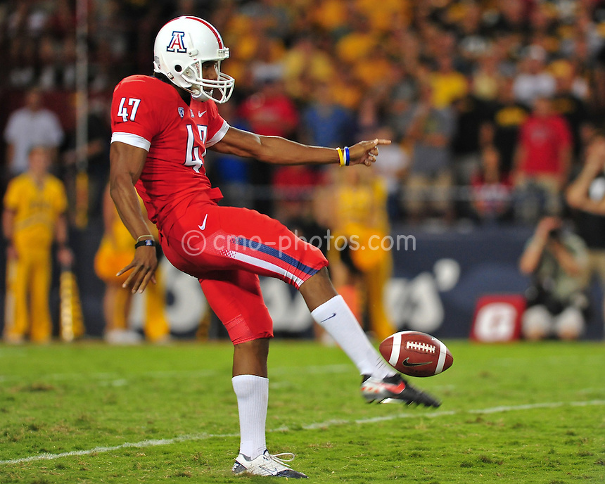 Sept 18, 2010; Tucson, AZ, USA; Arizona Wildcats punter Keenyn Crier (47) punts the ball in the 2nd quarter of a game against the Iowa Hawkeyes at Arizona Stadium.  Arizona won the game 34-27.