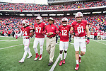 Wisconsin Badgers Honorary Captain Sidney Williams with captains D'Cota Dixon (14), Alec James (57), Natrell Jamerson (12), Troy Fumagalli (81) during an NCAA College Big Ten Conference football game against the Purdue Boilermakers Saturday, October 14, 2017, in Madison, Wis. The Badgers won 17-9. (Photo by David Stluka)