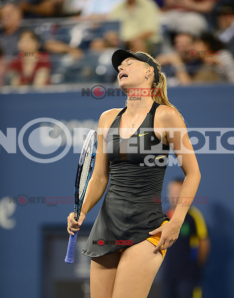 FLUSHING NY- SEPTEMBER 2: Maria Sharapova Vs Nadia Petrova on Arthur Ashe stadium at the USTA Billie Jean King National Tennis Center on September 2, 2012 in in Flushing Queens. Credit: mpi04/MediaPunch Inc. ***NO NY NEWSPAPERS*** /NortePhoto.com<br /> <br /> **CREDITO*OBLIGATORIO** <br /> *No*Venta*A*Terceros*<br /> *No*Sale*So*third*<br /> *** No*Se*Permite*Hacer*Archivo**<br /> *No*Sale*So*third*