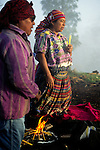 A K'iche' Maya woman priestess leads an indigenous spiritual ceremony near San Andres Xecul, Guatemala.
