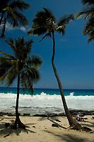 breaking wave and sunbathers during large surf at Magic sands beach, Kailua Kona The Big Island of Hawaii