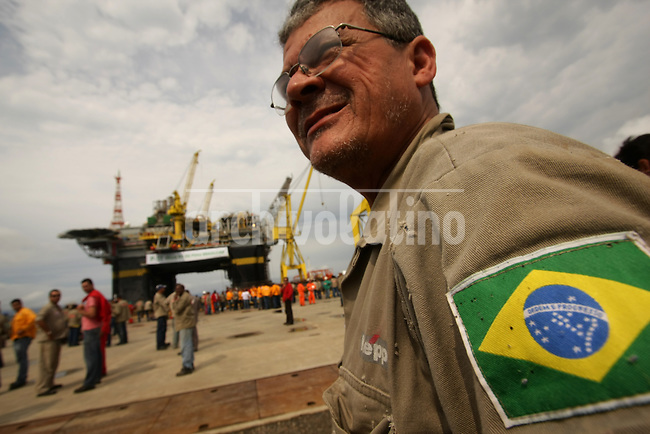 Workers listen to speeches at the inauguration of the Petrobras P51 platform near Angra dos Reis, Brazil, Oct. 8, 2008. The P51 is the first semi-submersible platform, touted as the world's largest, made entirely in Brazil. .