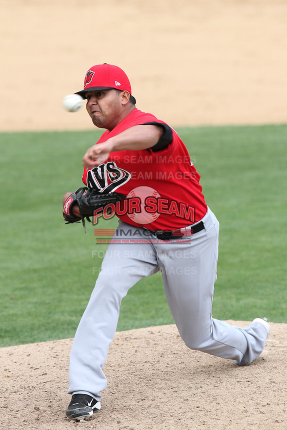 Jose Jimenez #22 of the High Desert Mavericks pitches against the Rancho Cucamonga Quakes at The Epicenter in Rancho Cucamonga,California on May 8, 2011. Photo by Larry Goren/Four Seam Images