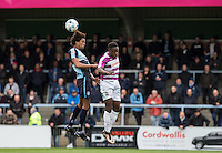Sido Jombati of Wycombe Wanderers & Andy Yiadom of Barnet go up for the ball during the Sky Bet League 2 match between Wycombe Wanderers and Barnet at Adams Park, High Wycombe, England on 16 April 2016. Photo by Andy Rowland.