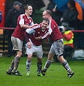 Culter players celebrate after Berwick's Michael Dunlop heads the ball into his own net for Culter's equaliser.