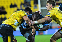 Hurricanes' Isaia Walker-Leawere and Beauden Barrett try to stop Bulls Trevor Nyakane during the Super Rugby quarterfinal between the Hurricanes and Bulls at Westpac Stadium in Wellington, New Zealand on Saturday, 22 June 2019. Photo: Dave Lintott / lintottphoto.co.nz
