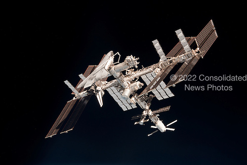 This image of the International Space Station and the docked space shuttle Endeavour, flying at an altitude of approximately 220 miles, was taken by Expedition 27 crew member Paolo Nespoli from the Soyuz TMA-20 following its undocking on May 23, 2011 (USA time). The pictures are the first taken of a shuttle docked to the International Space Station from the perspective of a Russian Soyuz spacecraft. Onboard the Soyuz were Russian cosmonaut and Expedition 27 commander Dmitry Kondratyev; Nespoli, a European Space Agency astronaut; and NASA astronaut Cady Coleman. Coleman and Nespoli were both flight engineers. The three landed in Kazakhstan later that day, completing 159 days in space..Credit: NASA via CNP