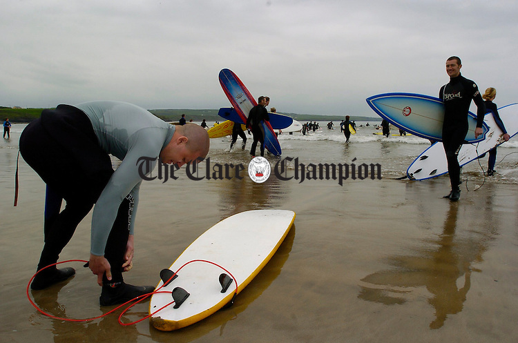 Eric Chandler of Ennis gets ready to take part  in the Lahinch Surfschool Crew's Surfing World Record Festival at Lahinch beach. Photograph by John Kelly.