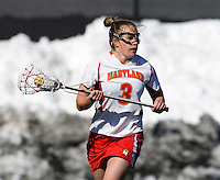 Caitlyn McFadden (3) of Maryland looks for an open teammate at the practice turf field in College Park, Maryland.  Maryland defeated Richmond, 17-7.