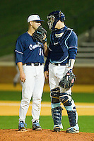 Relief pitcher Greg Holt #14 and catcher Jacob Stallings #5 of the North Carolina Tar Heels have a discussion on the mound during the game against the Wake Forest Demon Deacons at Gene Hooks Field on March 11, 2011 in Winston-Salem, North Carolina.  Photo by Brian Westerholt / Four Seam Images