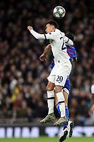 Dele Alli of Tottenham Hotspur and Mady Camara of Olympiacos  during Tottenham Hotspur vs Olympiacos FC, UEFA Champions League Football at Tottenham Hotspur Stadium on 26th November 2019