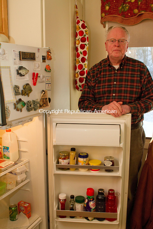 WATERTOWN, CT24 January 2014-012414LW01 - Wayne Clark, a resident of Truman Terrace in Watertown, stands by his refridgerator, which is from 1992 and doesn't work well. He said Patricia Norman, the executive director of the Watertown Housign Authority, is not responsive to his concerns about maintanance issues.<br /> Laraine Weschler Republican-American