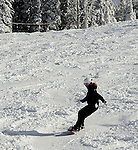 Snowboarder Emma Shapera on a sunny powder dayat Grand Targhee Resort, Wyoming
