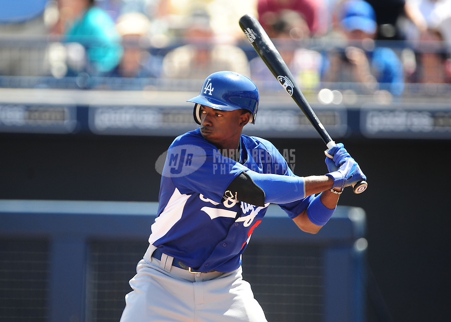 Mar. 27, 2012; Peoria, AZ, USA; Los Angeles Dodgers batter Dee Gordon bats in the first inning against the San Diego Padres at Peoria Stadium.  Mandatory Credit: Mark J. Rebilas-