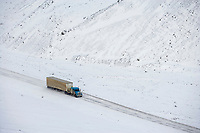 Truck hauls supplies over atigun pass in the Brooks Range, Arctic, Alaska.