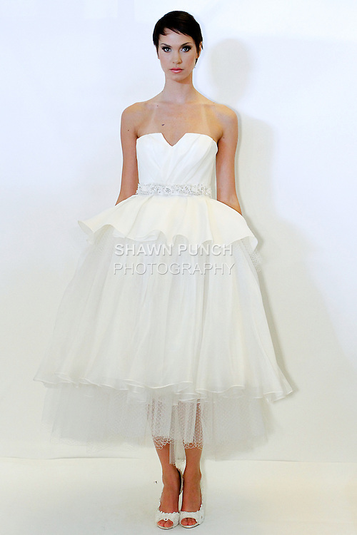 Model poses in a Lily bridal gown from the Rafael Cennamo Spring 2014 White Collection, during New York International Bridal Week, April 20, 2013.