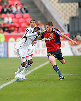 Real Salt Lake Midfielder Will Johnson (8) fights to get the ball from New England Revolution Midfielder Sainey Nyassi (31) in the Real Salt Lake 6-0 win over New England Revolution, April 25, 2009 at Rio Tinto Stadium in Sandy, Utah.