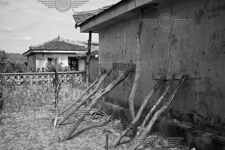 A damaged home in Pongchon county, DPRK photographed during a field visit by national and international Red Cross officials on Saturday August 27 2011. Consecutive floods caused by heavy rainfall and strong winds, together with the impact of typhoon Muifa which struck in early August, resulted in the destruction or severe damage of over 9,500 houses, rendering more than 25,000 people homeless between June 23 and August 9, according to data provided by the DPRK government. While flood damage was reported throughout the country, south and north Hwanghae provinces have been worst hit by the repeated flooding, leaving an already vulnerable population in a critical condition.  Photo by Morten Hvaal/Felix Features for IFRC.