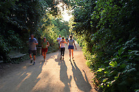 Green trees and green belt make the Lady Bird Lake Hike and Bike Trail a runners paradise in Austin, Texas