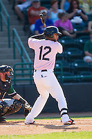 Nomar Mazara (12) of the Hickory Crawdads at bat against the Augusta GreenJackets at L.P. Frans Stadium on May 11, 2014 in Hickory, North Carolina.  The GreenJackets defeated the Crawdads 9-4.  (Brian Westerholt/Four Seam Images)